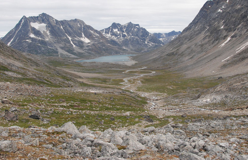 "We stayed 2 nights at our second camp, and did a day hike up the Tunup Kua (""the way behind"") valley.  Our camp is on the other side of the water in the distance."