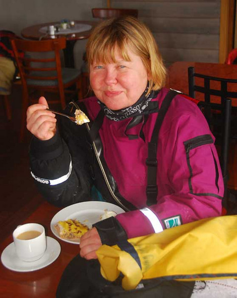 Here is Ann chowing down on some apple pie and ice cream in the Digermulen restaurant.  Note the dry suit, which we wore continuously while paddling in these cold waters.
