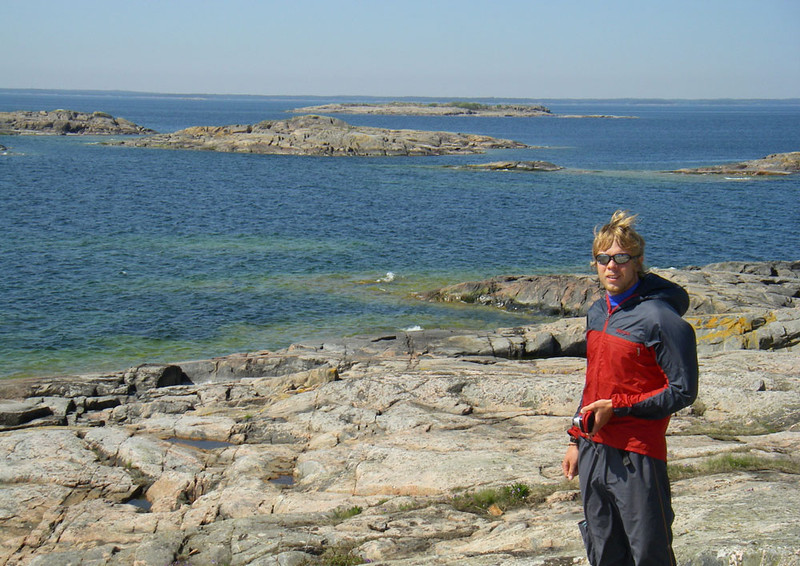 """This is my kayaking guide Joakim Danielsson, who runs an ecotourism and adventure company called Nordic Elements  <a href=""""http://www.nordicelements.se/en/index.html"""">http://www.nordicelements.se/en/index.html</a>).  I hired him to give me a 5 day trip to some of the outer island of the Tjust archpelago.  He was excellent and I highly recommend him (and he was recommended to me by my friend Lena Conlan of <a href=""""http://www.crossinglatitudes.com"""">http://www.crossinglatitudes.com</a>, also highly recommended).  The mainland is on the distant horizon."""