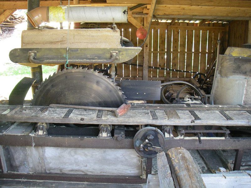 Here is the small sawmill.  The saw blade is about 4 feet in diameter.  Everything was hand made except for the saw itself.