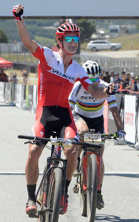. Sam Gaze, left, of New Zeland reacts as he beats reigning World Champion and Olympic gold medalist Nino Schurter of Switzerland during the Mens Pro Short Track race at the Sea Otter Classic Cycling Festival at Laguna Seca Raceway in Monterey on Friday April 21, 2017. (David Royal - Monterey Herald)
