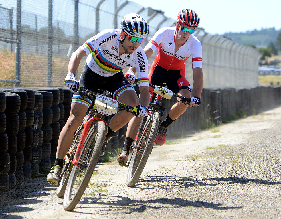 . Reigning World Champion and Olympic gold medalist Nino Schurter of Switzerland, left, leads Sam Gaze of New Zeland during the Mens Pro Short Track race at the Sea Otter Classic Cycling Festival at Laguna Seca Raceway in Monterey on Friday April 21, 2017. Gaze won the race, Schurter took second. (David Royal - Monterey Herald)
