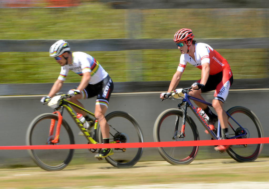 . Reigning World Champion and Olympic gold medalist Nino Schurter of Switzerland, left, leads Sam Gaze of New Zeland during the Sea Otter Classic Cycling Festival at Laguna Seca Raceway in Monterey on Friday April 21, 2017. Gaze won the race, Schurter took second. (David Royal - Monterey Herald)