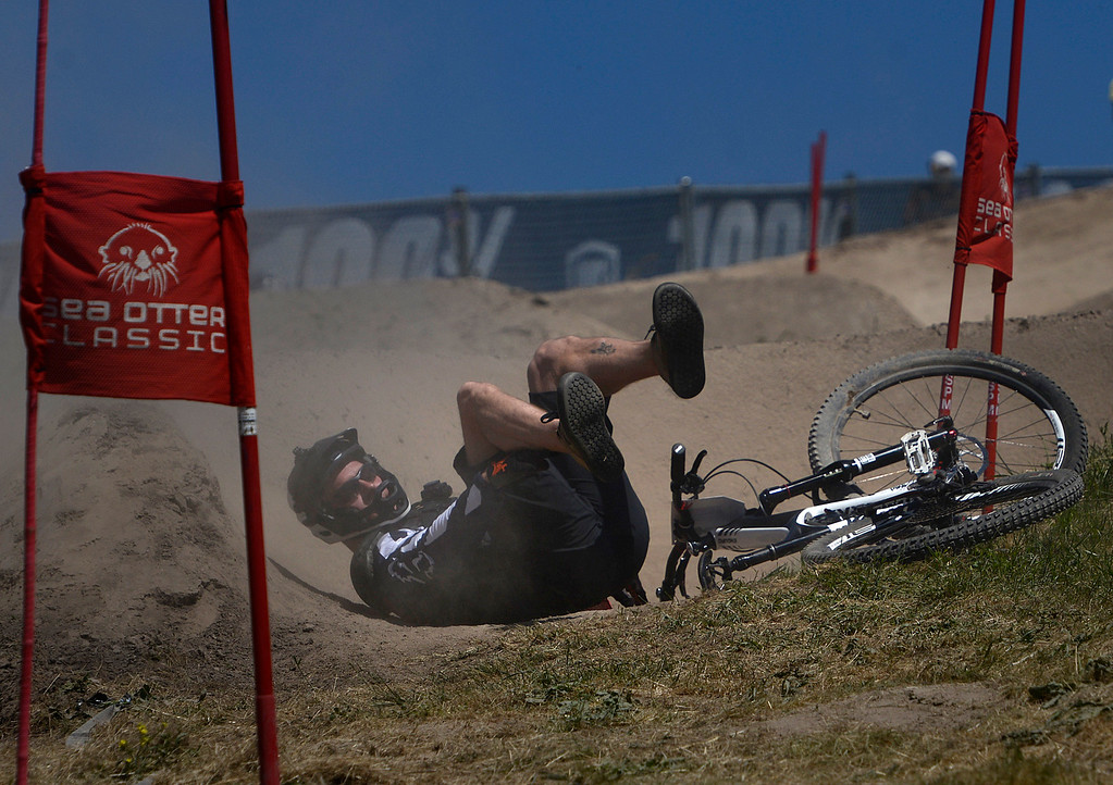 . A Dual Slalom racer crashes during practice rounds for the Sea Otter Classic Cycling Festival at Laguna Seca Raceway in Monterey on Friday April 21, 2017. (David Royal - Monterey Herald)