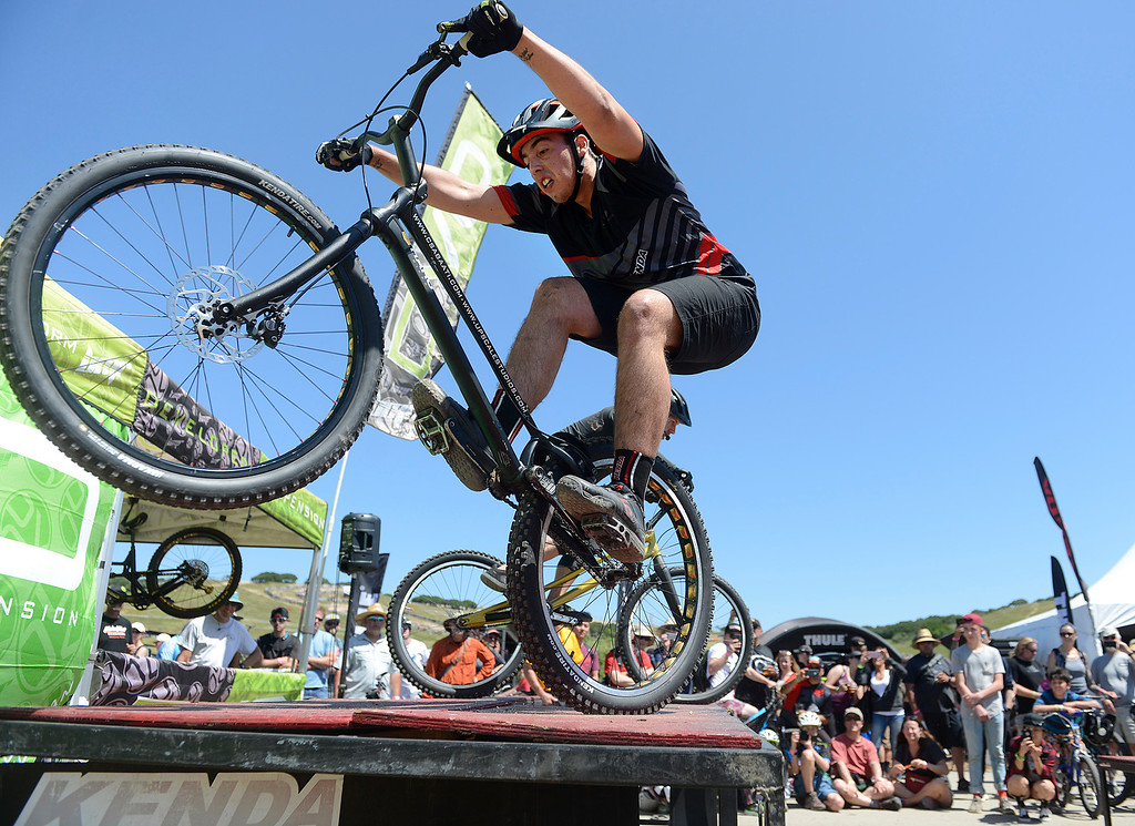 . Csaba Attila Pasztor, foreground, of Romania jumps onto a platform on his trials bike beside Mike Steidley during Steidley\'s stunt show at the Sea Otter Classic Cycling Festival at Laguna Seca Raceway in Monterey on Friday April 21, 2017. Steidley is a 12-time world champion trials rider. (David Royal - Monterey Herald)