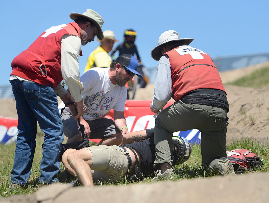 . Emergency personnel tend to a Dual Slalom rider who crashed during practice runs at the Sea Otter Classic Cycling Festival at Laguna Seca Raceway in Monterey on Friday April 21, 2017. (David Royal - Monterey Herald)