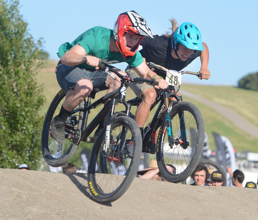 . Collin Hudson, left, and Kelly Cody race during the Pump Park Invitational Finals during the Sea Otter Classic Cycling Festival at Laguna Seca Raceway in Monterey on Friday April 21, 2017.  Hudson won the heat and the whole event on a burrowed bike. (David Royal - Monterey Herald)