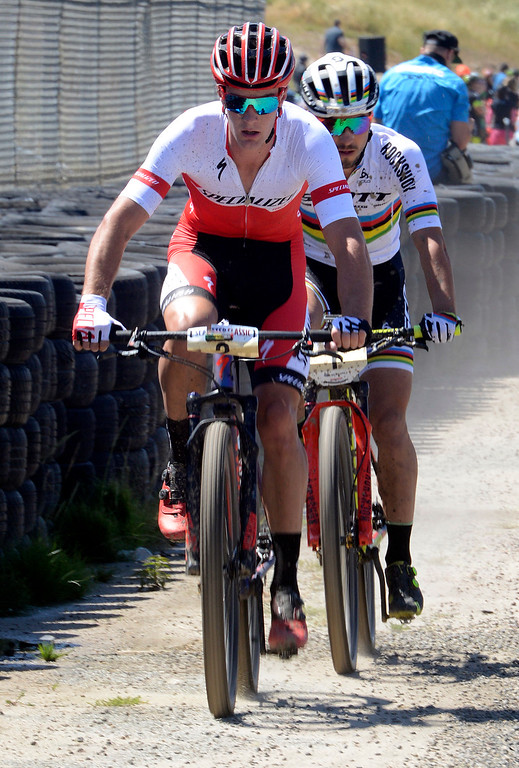 . Sam Gaze, left, of New Zeland leads reigning World Champion and Olympic gold medalist Nino Schurter of Switzerland during the Mens Pro Short Track race at the Sea Otter Classic Cycling Festival at Laguna Seca Raceway in Monterey on Friday April 21, 2017. Gaze won the race, Schurter took second. (David Royal - Monterey Herald)