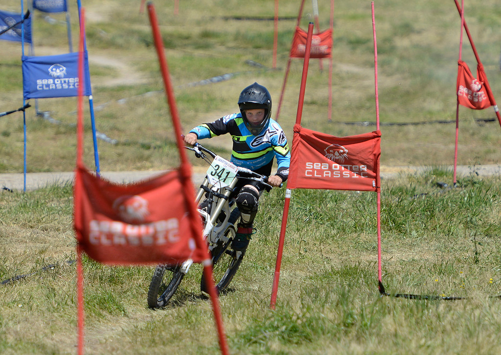 . Dual Slalom racer Dutch Petersen, 9, races during qualifying rounds for the Sea Otter Classic Cycling Festival at Laguna Seca Raceway in Monterey on Friday April 21, 2017. (David Royal - Monterey Herald)