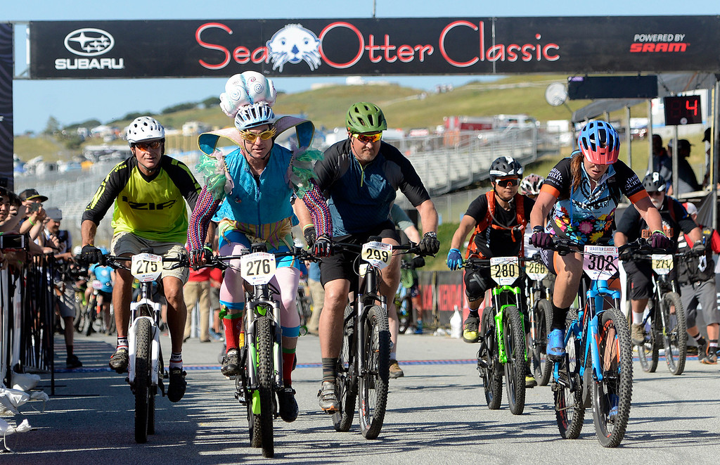 . Jeff McGrath of Salinas wears a costume as he takes off at the start of the combined 50-59 and 60 plus age divisions of the Haibike electric mountain bike race (e-MTB) race at Sea Otter Classic Cycling Festival at Laguna Seca Raceway in Monterey on Friday April 21, 2017. Haustwald was riding one of Haibike\'s electric bikes in the industry division.(David Royal - Monterey Herald)