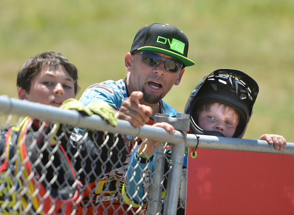. Mountain bike coach Mark Kugel of Salt Lake City points to features of the track while working with young Dual Slalom racers Chase Cambell, left, 13, and Dutch Petersen, 9, before qualifying rounds for the Sea Otter Classic Cycling Festival at Laguna Seca Raceway in Monterey on Friday April 21, 2017. (David Royal - Monterey Herald)