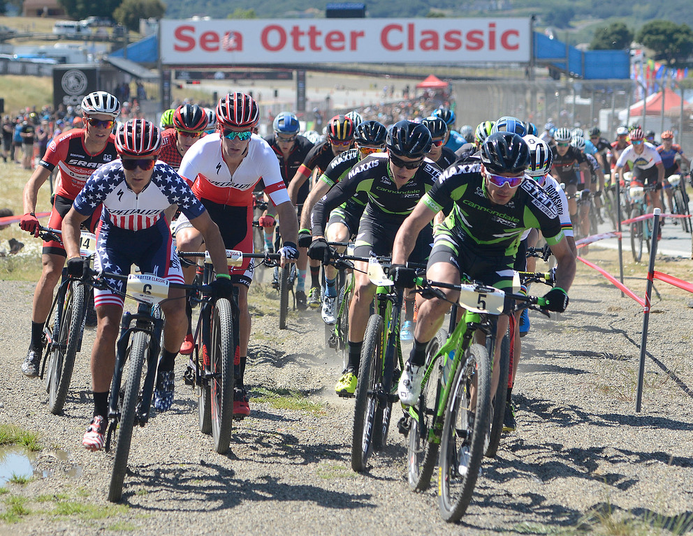 . Riders take off at the start of the Mens Pro Short Track race at the Sea Otter Classic Cycling Festival at Laguna Seca Raceway in Monterey on Friday April 21, 2017. Sam Gaze of New Zeland, who won the race is in white and red jersey at center. (David Royal - Monterey Herald)