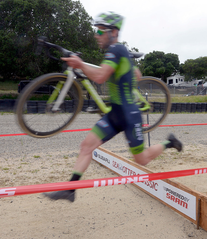 . Justin Lindine of Utah pedals jups a barried during the Pro Cyclocross Race during the during the Sea Otter Classic Cycling Festival at Laguna Seca Raceway in Monterey on Saturday April 22, 2017. (David Royal - Monterey Herald)