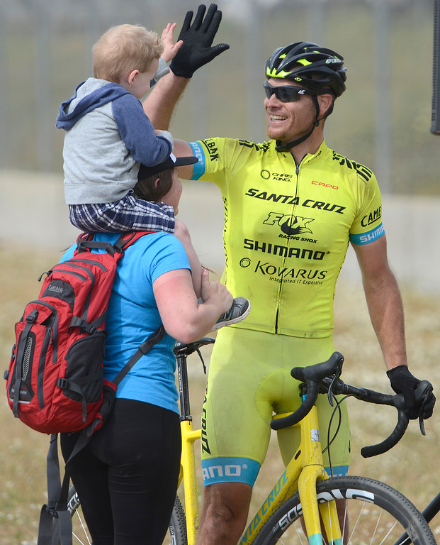 . Clint Classen, of El Dorado Hills greets his son Logan, 3, and wife Jen after winning the Open Single Speed Cyclocross Race during the Sea Otter Classic Cycling Festival at Laguna Seca Raceway in Monterey on Saturday April 22, 2017. (David Royal - Monterey Herald)