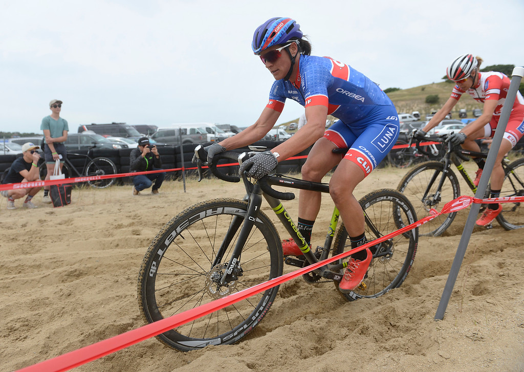 . Katerina Nash of the Czech Republic leads Rochet Maghalie of Quebec Canada through a sand trap during the Pro Cyclocross Race during the during the Sea Otter Classic Cycling Festival at Laguna Seca Raceway in Monterey on Saturday April 22, 2017. Nash won the race, Maghalie took second. (David Royal - Monterey Herald)