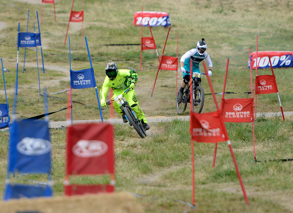 . Mitch Ropelato, left leaves Kyle Warner in the dust on his way to winning the Pro Men\'s Dual Slalom at the Sea Otter Classic Cycling Festival at Laguna Seca Raceway in Monterey on Saturday April 22, 2017. (David Royal - Monterey Herald)