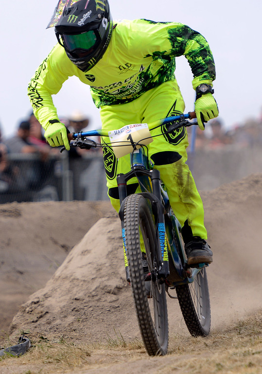 . Mitch Ropelato flies down the hill on his way to winning the Pro Men\'s Dual Slalom at the Sea Otter Classic Cycling Festival at Laguna Seca Raceway in Monterey on Saturday April 22, 2017. (David Royal - Monterey Herald)