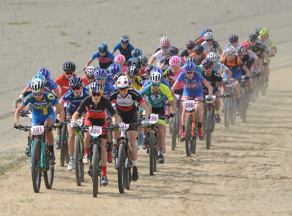 . Kate Courtney (205) of Morgan Hill leads the pack on her way to a win during the Women\'s Pro Cross Country Mountain Bike race during the Sea Otter Classic Cycling Festival at Laguna Seca Raceway in Monterey on Saturday April 22, 2017. (David Royal - Monterey Herald)