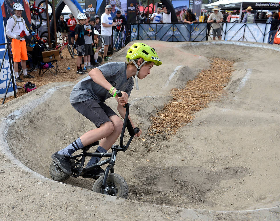 . Canyon Wilcox, 13, of Santa Barbara County competes on a mini pump track during the Sea Otter Classic Cycling Festival at Laguna Seca Raceway in Monterey on Saturday April 22, 2017. (David Royal - Monterey Herald)