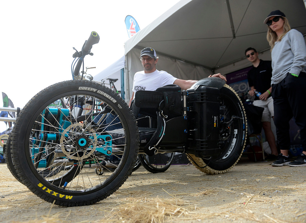 . Machinist and athlete Christian Bagg show off the Icon Explorer adaptive hand cycle for physically challenged people in his booth at the Sea Otter Classic Cycling Festival at Laguna Seca Raceway in Monterey on Saturday April 22, 2017. (David Royal - Monterey Herald)