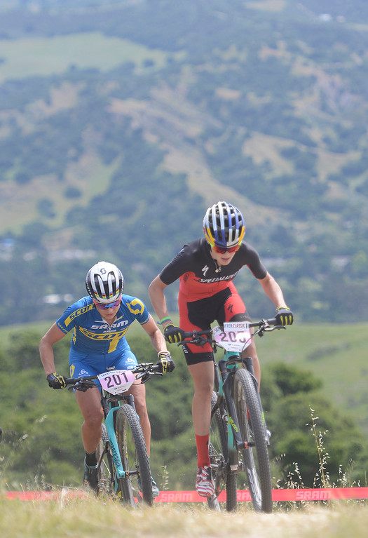 . Kate Courtney of Morgan Hill leads Jenny Rissveds of Sweden on her way to a win during the Women\'s Pro Cross Country Mountain Bike race during the Sea Otter Classic Cycling Festival at Laguna Seca Raceway in Monterey on Saturday April 22, 2017. Rissveds finished third. (David Royal - Monterey Herald)