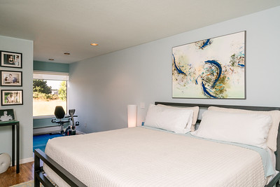 Master bedroom with view into the adjoining office/sitting area/exercise space