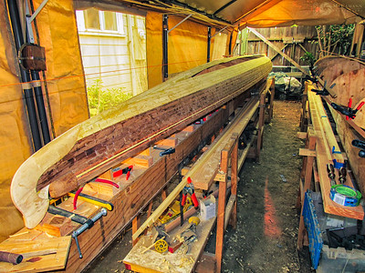 Filling in the hull strips with Alaskan yellow cedar.  August 1, 2015.