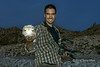 Look alike smiles<br /> <br /> Photographer holding a dried puffer fish, Isla San Francisco, Baja