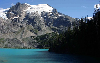 Upper Joffre Lake in front of Slalok Mountain. This lake is ~5.5 km from the trailhead and can be reached within several hours of moderate hiking. A camping spot is located at the South end of the lake, just below Matier Glacier. This lake can thank its brilliant blue-turqouise color to the light filtering effect of rock flour (a powdery substance that the glaciers grind off the mountain rocks) in the glacial runoff. The rock flour suspended in the water filters out much of the light spectrum, leaving this remarkable turquoise blue color.