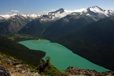"""Cheakamus Lake from the summit of Flute Peak. We didn't realize that one of the biggest payoffs of a hike up Flute Peak was the amazing view of Cheakamus Lake. Believe it or not, there is no editing done to this picture. The water really is this color...This is why BC's tourism slogan starts with """"Supernatural"""". A very worthwhile day trip that starts on the Whistler gondola, continues on the Peak Chair to the summit of Whistler Peak. From there, it's an hour or two hike over the Musical Bumps to the summit of Flute. This was Niko's first major BC summit."""