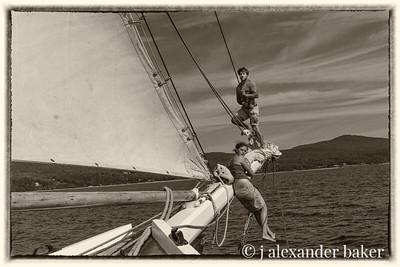 Mate Zach and crew member, Becky, furling headsails, schooner Mercantile, Penobscot Bay, Maine