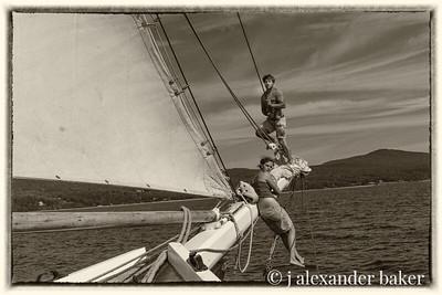 Mate Zach and crew member, Becky, furling headsails, schooner Mercantile, Penobscot Bay, Maine