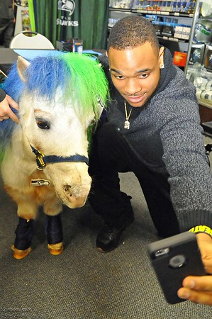 01-12-2016 Thomas Rawls Signing With Wilson the 12th Pony