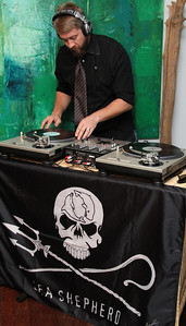 """DJ MC (Mark Carter) spins the tunes. Go Green Expo Presents """"A Toast to Captain Paul Watson"""" held at the GREEN+VINE at the Residences at W Hollywood in West Hollywood, CA on April 14, 2011. Event hosted by Nicole Landers and Bradford Rand.  Photos by Erin Suggett for Sea Shepherd. © Erin Suggett Photography 2011. All Rights Reserved."""