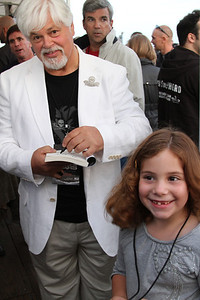 "Captain Paul Watson makes a young supporter smile.  Animal Planet's Whale Wars Season 4 Premier: ""Operation No Compromise"" Antarctic Campaign. Hosted by Animal Planet, L.A. Times & Brand X at the Santa Monica Pier in Santa Monica, CA. Photography by Erin Suggett for Sea Shepherd. June 3, 2011 All Rights Reserved."
