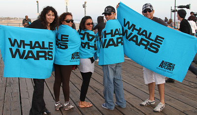 "Happy supporters show off their towels.  Animal Planet's Whale Wars Season 4 Premier: ""Operation No Compromise"" Antarctic Campaign. Hosted by Animal Planet, L.A. Times & Brand X at the Santa Monica Pier in Santa Monica, CA. Photography by Erin Suggett for Sea Shepherd. June 3, 2011 All Rights Reserved."