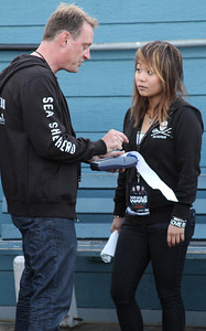 "Sea Shepherd volunteer David Hance & L.A. Coordinator Grace Ko conduct business.  Animal Planet's Whale Wars Season 4 Premier: ""Operation No Compromise"" Antarctic Campaign. Hosted by Animal Planet, L.A. Times & Brand X at the Santa Monica Pier in Santa Monica, CA. Photography by Erin Suggett for Sea Shepherd. June 3, 2011 All Rights Reserved."