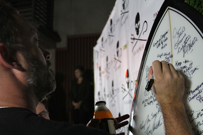 "Captain Chuck Swift signs the Sea Shepherd surfboard for charity auction.  Sea Shepherd launch party for the ""Operation No Compromise"" Antarctic Whale Defense Campaign and the Gojira Interceptor Vessel unveiling in Los Angeles, CA. on October 23, 2010"