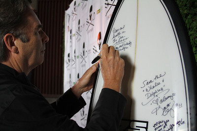 "Actor Beau Bridges sign the SSCS surfboard for auction.  Sea Shepherd launch party for the ""Operation No Compromise"" Antarctic Whale Defense Campaign and the Gojira Interceptor Vessel unveiling in Los Angeles, CA. on October 23, 2010"