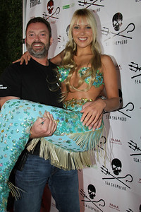 "Captain Chuck Swift poses with hannah Mermaid on the red carpet.  Sea Shepherd launch party for the ""Operation No Compromise"" Antarctic Whale Defense Campaign and the Gojira Interceptor Vessel unveiling in Los Angeles, CA. on October 23, 2010"