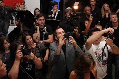 """The crowd partakes in capturing footage of the auction items.  Sea Shepherd launch party for the """"Operation No Compromise"""" Antarctic Whale Defense Campaign and the Gojira Interceptor Vessel unveiling in Los Angeles, CA. on October 23, 2010"""