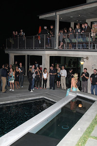 "Party guests photograph Hannah Mermaid near the pool.  Sea Shepherd launch party for the ""Operation No Compromise"" Antarctic Whale Defense Campaign and the Gojira Interceptor Vessel unveiling in Los Angeles, CA. on October 23, 2010"