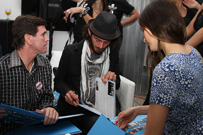 """Actress Isabel Lucas and Lincoln O'Barry sign copies of """"Sea Voices"""".  Sea Shepherd launch party for the """"Operation No Compromise"""" Antarctic Whale Defense Campaign and the Gojira Interceptor Vessel unveiling in Los Angeles, CA. on October 23, 2010"""