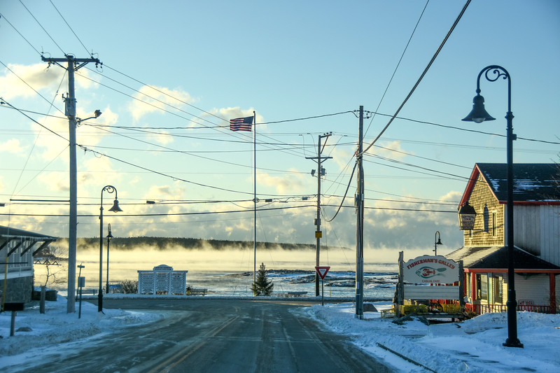 Downtown Winter Harbor with Henry Cove covered with Sea Smoke