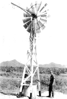 HM2 Saft of Team 0106 shows a Vietnamese father how to operate a windmill which the Corpsman installed near the Binh Tuy Province Agricultural School.<br /> Photo: Seabee Team Deployment Completion Report