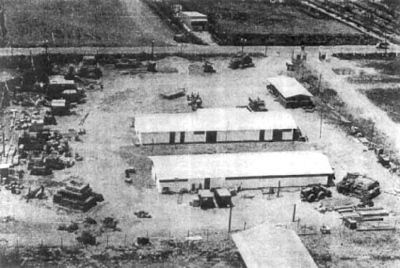Seabee Team Compound under construction near Ben Tre, Kien Hoa Province. Three structures within the compound were (1) Team House and mess hall in the foreground, (2) the shops, and (3) the quarters for the guards. Additional shop facilities were added later.<br /> Photo: Seabee Team Deployment Completion Report