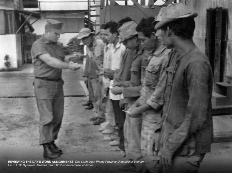 Reviewing the day's Work Assignments: Cao Lanh, Kien Phong Province, RVN<br /> l to r: UTC Synowiez, Seabee Team 0313's Vietnamese Workmen