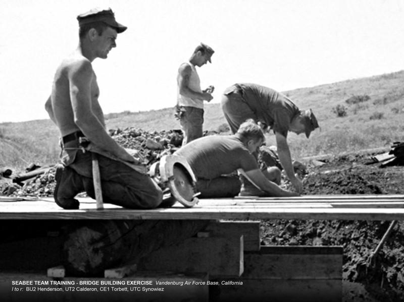 Seabee Team Training-Bridge Building Exercise-Vandenburg Air Force Base, CA.<br /> l to r: BU2 Henderson, UT2 Calderon, CE1 Torbett, UTC Synowiez