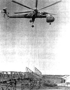 Team 0410 teams up with the giant CH-54 sky crane to place a 21 meter Eiffle section for the Rach Chanh Bridge in Long An Province. The bridge had been destroyed 6 years before.<br /> Photo:Seabee Team Deployment Completion Report