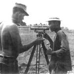 EAS3 Cottrell of Team 0511 explains the surveying level to his Vietnamese trainee at the Provincial Maintenance Shop site in Bao Trai, Hau Ngai Province.<br /> Photo: Seabee Team Deployment Completion Report